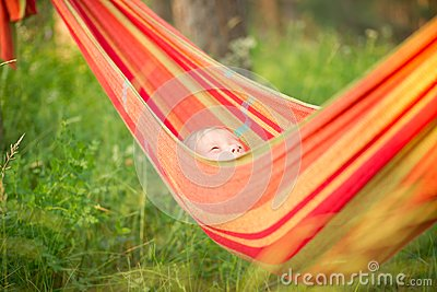 Adorable baby relaxing in hammock