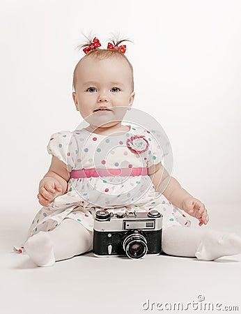 Adorable baby with retro camera
