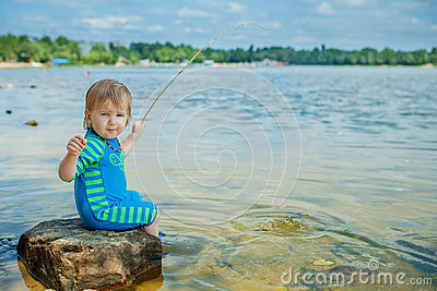 Adorable baby on river with fishing rod stock photo for Baby fishing pole