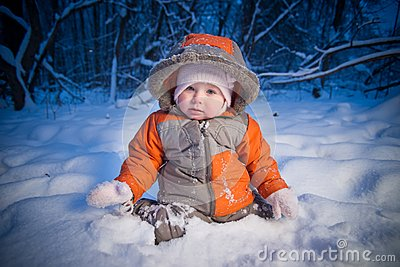 Adorable baby sit in deep snow