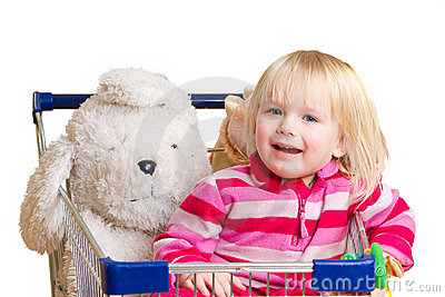 Adorable baby with toys in shop cart
