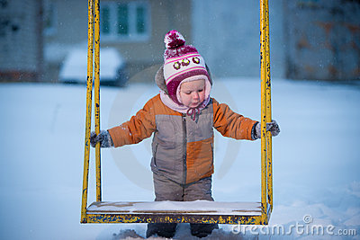 Adorable baby on winter playground