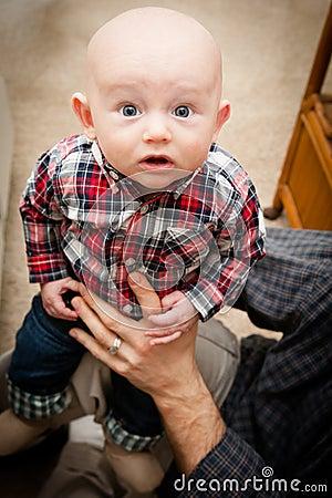 Adorable Bald Baby Boy With Big Blue Eyes