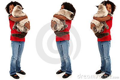 Adorable Black Child Holding A Large Cat