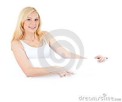 Adorable blonde girl displaying big copyspace