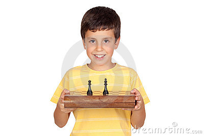 Adorable boy with chessboard