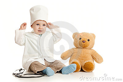 Adorable boy with clothes of doctor and teddy