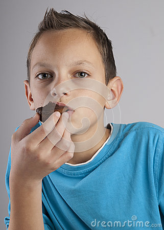 Adorable boy eating cookies