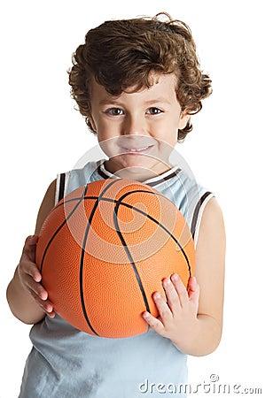 Adorable boy playing the basketball