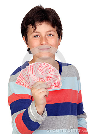 Adorable boy playing cards