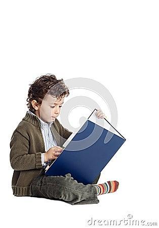 Adorable boy reading a book