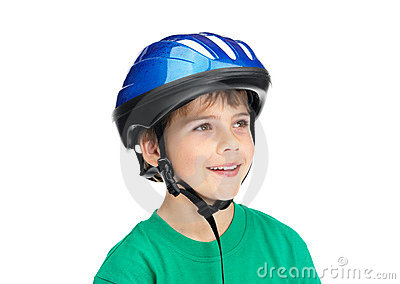 Adorable boy wearing a helmet and looking away