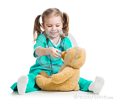 Adorable child with clothes of doctor and teddy bear