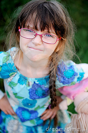Free Adorable Child Girl In Glasses Makes Angry Face Royalty Free Stock Photo - 20660205