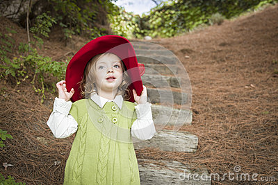 Adorable Child Girl with Red Hat Playing Outside