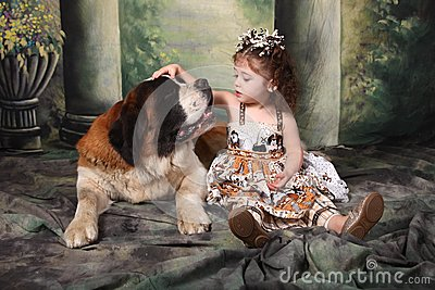 Adorable Child and Her Saint Bernard Puppy Dog