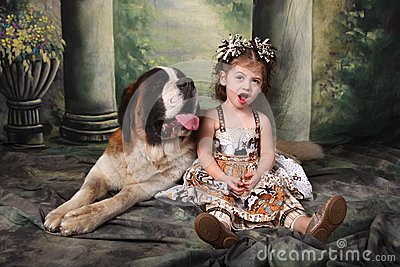 Adorable Child and Her Saint Bernard Puppy Dog