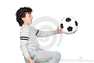 Adorable child playing with a soccer ball
