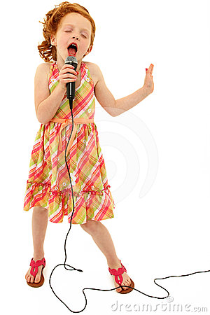 Free Adorable Child Singing Into Microphone Stock Image - 24583551