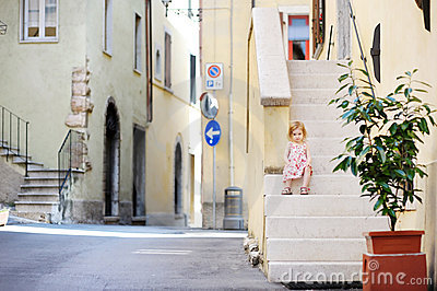 Adorable child sitting on the stairs