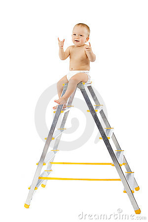 Adorable child sitting on top of stepladder