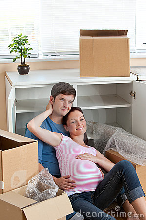 Adorable couple lying in their new house