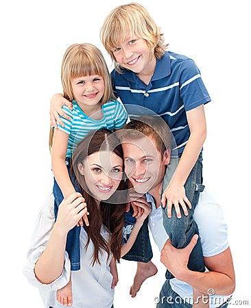 Adorable family enjoying piggyback ride