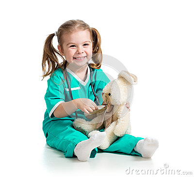 Adorable girl with clothes of doctor with toy