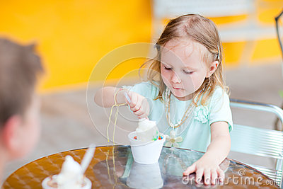 Adorable girl eating ice cream