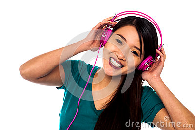 Adorable girl enjoying music