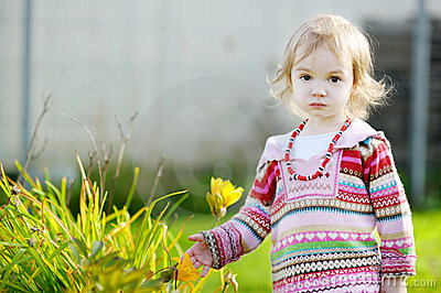 Adorable girl outdoors on beautiful autumn day