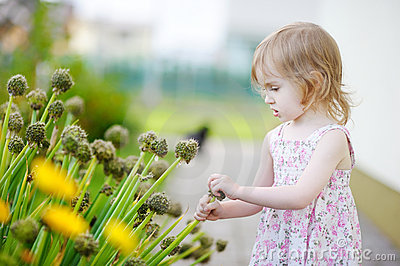 Adorable girl outdoors on beautiful summer day