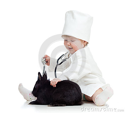 Adorable kid with clothes of doctor and pet bunny