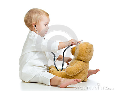 Adorable kid with clothes of doctor and teddy bear