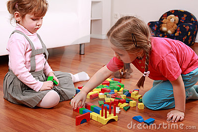 Adorable kids playing with blocks