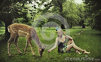 Adorable lady playing with deer
