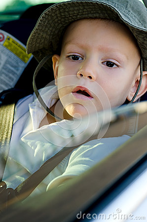 Adorable little boy in a car