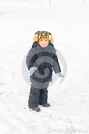 Free Adorable Little Boy Standing In Snow Stock Image - 28485081