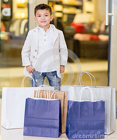 Adorable little boy shopping