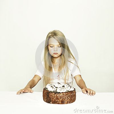 Adorable little girl with cake