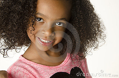 Adorable little girl with curly hair