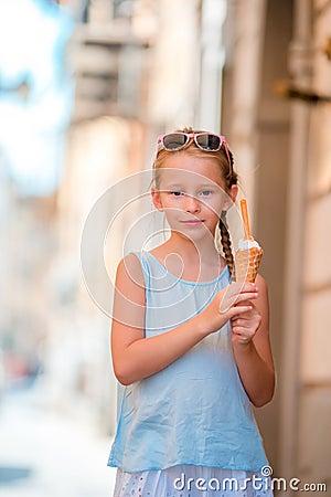 Free Adorable Little Girl Eating Ice-cream Outdoors At Summer. Cute Kid Enjoying Real Italian Gelato Near Gelateria In Rome Stock Image - 80868041