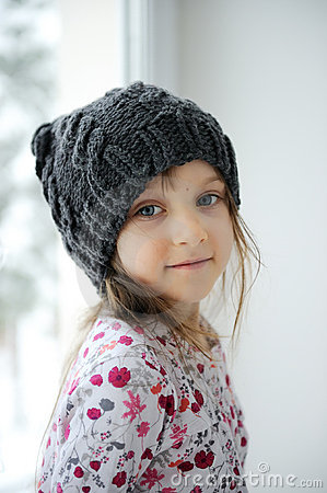 Adorable little girl in grey knit