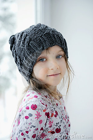 Adorable little girl in grey knit hat