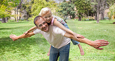 Adorable little girl having fun with her father