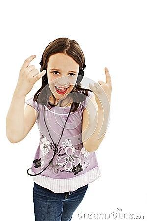 Adorable little girl with headphones