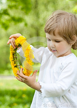 Adorable little girl holding flower chaplet