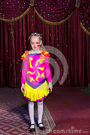 Free Adorable Little Girl In A Pink And Yellow Costume Royalty Free Stock Photography - 53760727