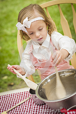 Adorable Little Girl Playing Chef Cooking