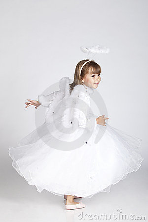 Adorable little girl posing as an angel flying